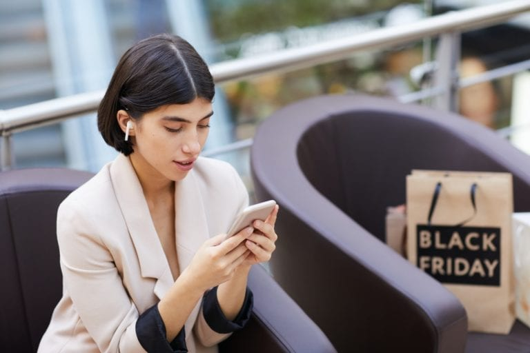 Beautiful Woman using Smartphone While Relaxing in Shopping Mall